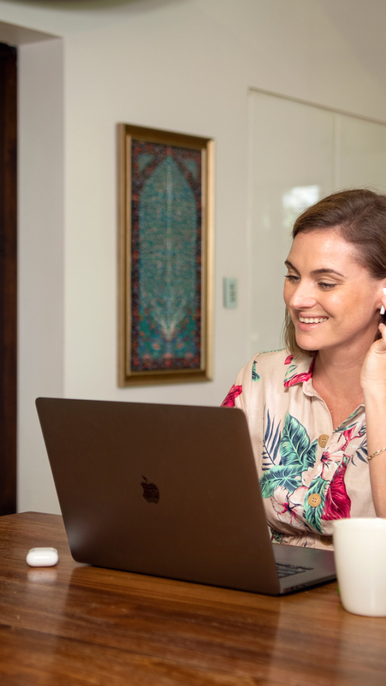 Woman smiling studying from home online